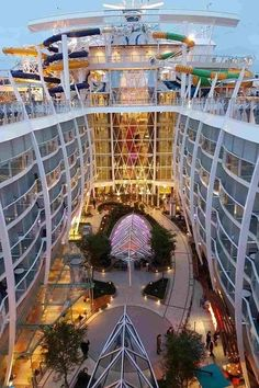 Harmony of the Seas | Majestic and striking, this state of the art vessel is going to change what people think about going on a cruise. Central Park, pictured here, is full of live trees and interesting shops. #royalcaribbeancruisetips