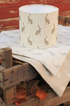 Beautiful Olive Mini Hares by Peony and Sage. Lampshades made by Olly and Boo. Swedish Grey and Dove Mini hares beneath