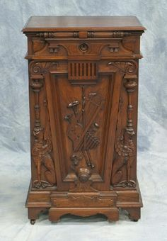 209: Carved walnut Victorian music cabinet in the Aesth : Lot 209