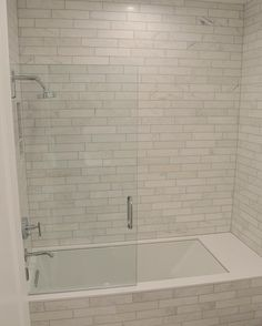 Marbel tile tub surround with gray grout                                                                                                                                                                                 More