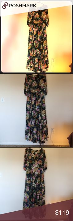 Floral Maxi by Yumi Kim. Size Large. Black floral maxi dress by Yumi Kim. 3 quarter sleeves with long asymmetric hem. Dress runs 60 inches from the shoulder, so you need to be very tall or have a good heel. Fits slightly small on top. Lightly worn. Size large. Anthropologie Dresses Maxi