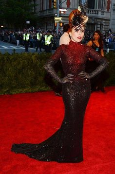 Ranking the Met Gala Red Carpet from Most Punk to Least Punk: MOST PUNK: Paloma Faith in Michael Cinco This look requires commitment--not to mention a high tolerance for having things obstructing your line of vision. More of this on the red carpet please! Paloma Faith, Michael Cinco Gowns, Punk Chic, Backless Gown, Met Gala Red Carpet, Glamour, Costume Institute, Nice Dresses, Grey Dresses
