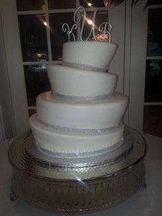 Calumet Bakery  White topsy turvy cake with rhinestone trim