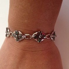 Bracelet Silver bracelet with flower shaped stones(NEW) No Trades.                                                                 No Holds.                                                                 No PayPal. Jewelry Bracelets