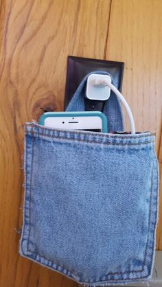 Recycled Jean pocket for holding iphone.