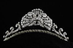 A 1930's diamond parure which assembles into the tiara pictured or similar necklace. Comprises a pair of dress clips with brooch fitting, which combine to form the center butterfly style motif, and the two scrolling sides (necklace or tiara) total weight excess of 10 carats.  See Tiaras Off the Frame board for all the elements