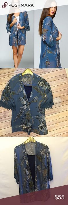 """New! S-L Spring Floral Kimono This is gorgeous in person! Such a pretty pattern and perfect to dress up and stay cool! Small - Large. 100% Polyester and made in USA. Approx 33"""" and it's an open airy fit! Pair with the navy or black Camisole. Tops"""