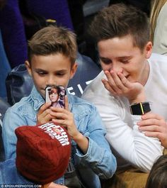 can we all just appreciate how david beckham's son has a justin bieber phone case aw