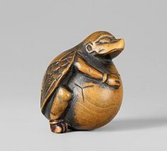 A boxwood netsuke of a tengu no tamago. Early 19th century