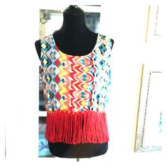 Cute Top with Fringe $7 sale Cute top with fringe at bottom great colorful print . New with tag ,short style top , . Polyester fabric light weight it feels like chiffon Size large junior IKY ME Tops