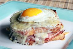 Croque Madame, Black Forest Ham on French Loaf Smothered w/ Bechamel and Gruyere Topped w/ a Fried Egg