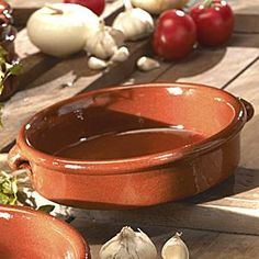 Spanish cazuelas:  they come in all sizes so are perfect for holding anything from a small tapas dish to a full-on casserole