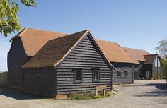 Two barns converted into a home using traditional materials and building techniques