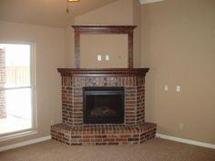 small brick corner fireplace More