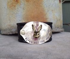 We're All Mad Here Leather Cuff by TheDoveCoteBrocante on Etsy