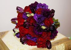 Oh my gosh, this was literally my bouquet! :) Red and purple love.