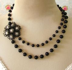 Vintage Black Enamel Flower with Cream Moonstone Accents on Double Strand Black Glass Bead Necklace