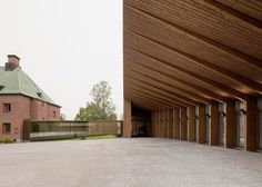 For the extension of a museum in Mänttä, Finland, Spanish studio MX_SI proposed a building with mullioned wooden cladding.