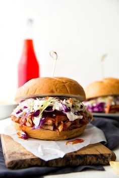 Simple (dump it and forget about it) BEST EVER slow cooker pulled pork sandwiches with a delicious sweet honey chipotle sauce and an easy coleslaw.