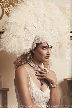 Stella-Maris Showgirl Headpiece in winter white by Peacock Blue Design Studio | fashion photography/ set design: Go ForWard Phototography | Styling: Andrea D. Wynn & Andre Wallace | Makeup: Jessie Campbell | Hair: Wendy Ward | Model: Juelles Chester @ Red Star Model Management | Dreamingless Magazine December 2015 | off white feather headpiece, ecru beaded headpiece | perfect for Mardi Gras, Carnivale, Masquerade Ball, Costume Ball, Fancy Dress Party, New Year's Eve party and Burlesque…
