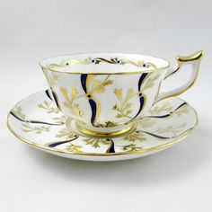 Royal Chelsea Tea Cup and Saucer with Blue and Gold Pattern