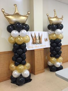 Gold, black, and white King balloon columns