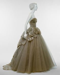 """""""Venus""""  House of Dior  (French, founded 1947)  Designer: Christian Dior (French, 1905–1957) Date: fall/winter 1949–50 Culture: French Medium: silk, sequins, rhinestones, simulated pearls"""
