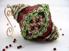 I love ornaments that are not just round shaped.  I love the pattern beaded into this.