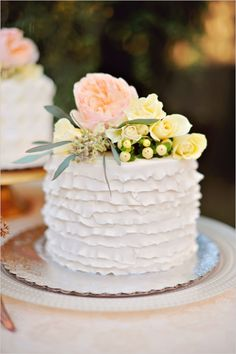 ruffled white wedding cake with floral topper #miniweddingcake #ruffledcake #weddingchicks http://www.weddingchicks.com/2014/04/04/sun-kissed-romantic-wedding/