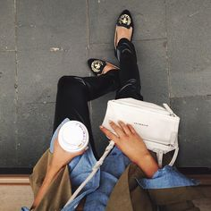 Black velvet skinnies, chambray top, camel jacket, black loafers with gold details and white bag.
