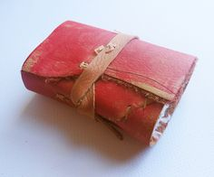 Handmade paper leather journal with visible and decorative stitch.