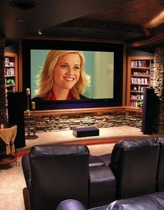 Media room...like stone, shelves, and crown molding around screen