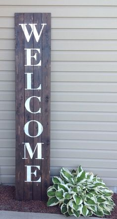 Complete your rustic decor with this huge oversized front porch Welcome sign. This large sign is also great for indoors as well! Measuring at 13-3/4 wide by 72 high (6 ft) this sign is sure to draw attention. White lettering compliments the dark stain on the pallet design. Measurements: Sign dimensions: 13-3/4 inches wide by 72 inches high (6 ft) What is Included: 1 oversized Welcome sign Please note: These items are handmade, hand cut, and hand painted. There may be knots and im...
