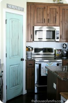 Ahhh beautiful blue door and great cabinets!