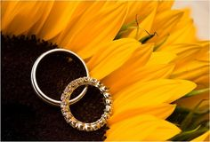 Sunflower wedding ring shot! Love this, it will be perfect since my flowers will be sunflowers!