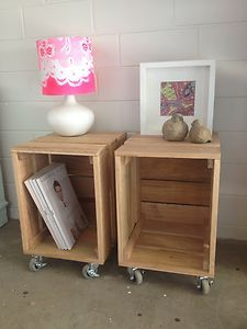 bedside table using crate and wheels - I would prolly paint these white to go with my other furniture.