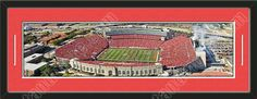 One framed large University of Nebraska stadium panoramic, double matted in team colors to 39 x 13.5 inches.  The lines show the bottom mat color.  $129.99 @ ArtandMore.com
