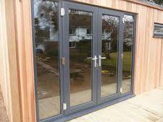 dark grey window frames with timber cladding