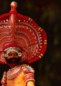 """Man Dressed For Theyyam Ritual With Traditional Painting On His Face, Thalassery, India"