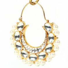 Gold plated crescent shaped earrings that feature classic kundan settings and decorated with cultured pearls.