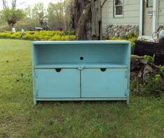 Her bed and dresser are white, but I would love to accent with pieces like this blue cabinet