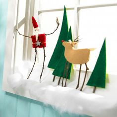 Use a windowsill to capture this festive Holiday scene. More Christmas crafts ideas: http://www.bhg.com/christmas/crafts/here-comes-santa-claus/?socsrc=bhgpin122513santaandrudolph&page=13