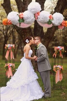 Wedding arch! No flowers. Cheaper? I am in love with the tissue poms and paper bunting!