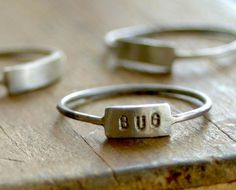 sterling silver nameplate ring. An uncomplicated rectangular piece of sterling silver adorns this modern ring.
