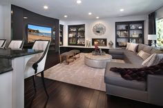 Contemporary living room with HUGE custom curved TV.  9.2 surround Bowers and Wilkins.