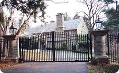 Automatic wrought iron driveway entry gate. Would really love this!