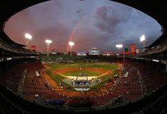 #WorldSeries2013 IN this image taken with a fisheye lens, Boston Red Sox players take batting practice as a rainbow appears in the sky above Fenway Park Tuesday, Oct. 22, 2013, in Boston. The Red Sox are scheduled to host the St. Louis Cardinals in Game 1 of baseball's World Series on Wednesday. (AP Photo/Elise Amendola)