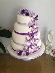 Had made purple butterfly wedding cake