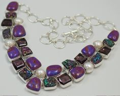 This is a .925 Sterling Silver necklace with top grade natural gem stones. The stones are purple turquoise, titanium druzy ( these are very sparkly), amethyst and river pearl.