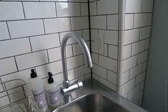 Here's a tip if you want a nice, crisp caulk line in your corners: PAINTER'S TAPE. It works really well. Just make sure you pull it off immediately after running/smoothing your caulk bead—don't let the caulk dry first. Schluter Tile Edge, Door Sixteen, Herringbone Subway Tile, Subway Tile Showers, Tile Trim, Interior Work, Wall Decor Pictures, Tile Projects, Downstairs Bathroom